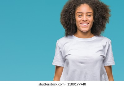 Young afro american woman over isolated background with a happy and cool smile on face. Lucky person.