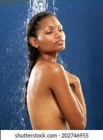 Young afro american woman taking shower.