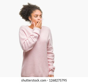 Young afro american woman wearing winter sweater over isolated background bored yawning tired covering mouth with hand. Restless and sleepiness.