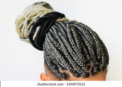 """Young afro with blonde Box braids, African hair style also known as """"Kanekalon braids."""" Close up on decoration and style."""