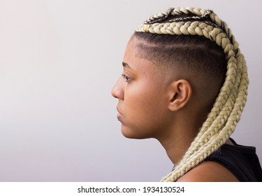 "Young afro with blonde Box braids, African hair style also known as ""Kanekalon braids."" Close up on decoration and style. Copy space."