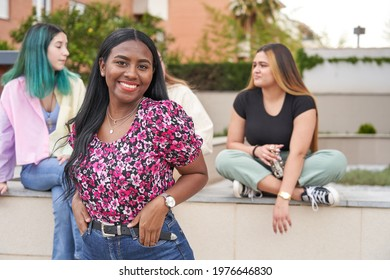 Young afro woman in front of her friends. Multi-ethnic group