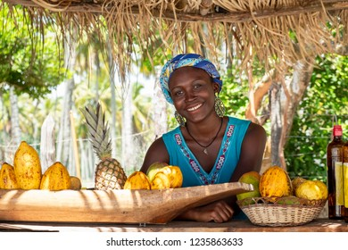 A young Afro-Brazilian waitress at a juice bar on the beach in Bahia