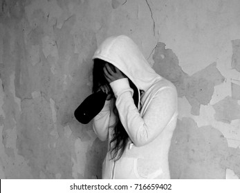 Young alcohollic women with alcohol bottle, alcohol addiction