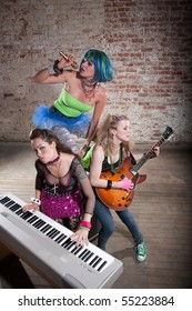 Young all girl punk rock band performing