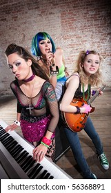 Young all girl punk rock band performs