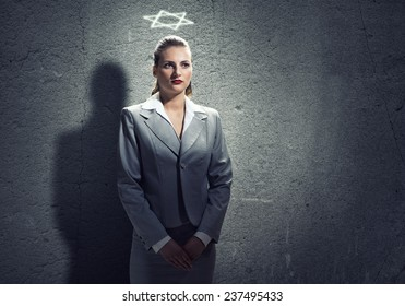 Young ambitious businesswoman with crown on head