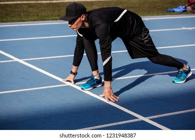 young ambitious sportsman is ready for sprint. side view full length photo. copy space