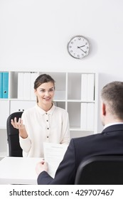 Young and ambitious woman during job interview in corporation