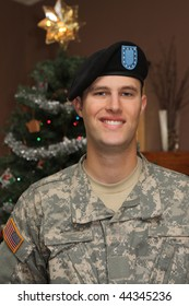 Young American ARMY Soldier in Uniform home for the Holidays