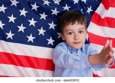 Young American boy and  flag at 4th July. Patriotic holiday. Fourth of July Independence Day in the United States