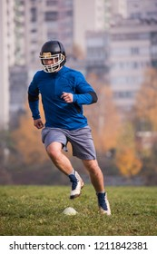 young american football player in action during the training at field