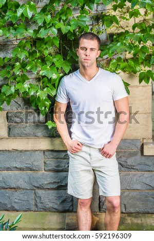 9f762564cdb Young American Man Wearing White V Stock Photo (Edit Now) 592196309 ...
