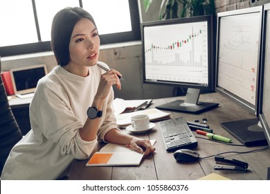 Young analyst, trader, marketer or advertiser working in the office
