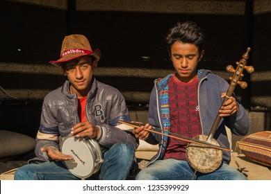 Young Anatolian Street Musicians with Traditional Instruments Hasankeyf village bazaar in Batman, Turkey. November 2018