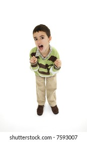 Young angry caucasian boy dressed in a casual outfit and standing on a white background.