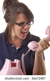Young angry woman yells into the telephone; isolated on a white background