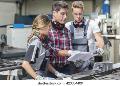 young apprentice with professional metallurgist