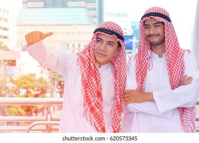 Young Arab businessman with background light adjustment