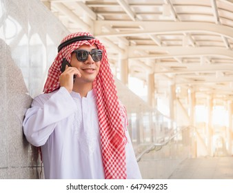Young arab businessman using cell phone for business connection