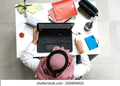 a young arab businessman working on laptop at the desk