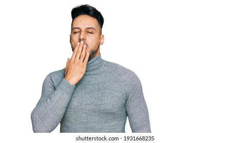 Young arab man wearing casual clothes bored yawning tired covering mouth with hand. restless and sleepiness.