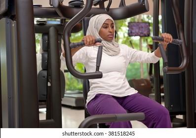 Young arab muslim woman working out in a Gym, Dubai, UAE