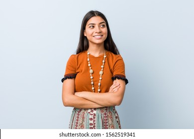 Young arab woman smiling confident with crossed arms.