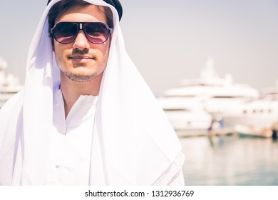 Young Arabian Man Next To A Yacht Port