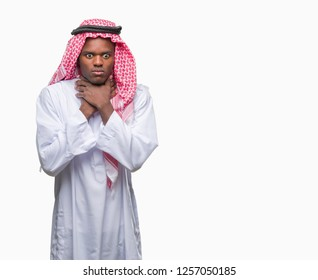 Young arabic african man wearing traditional keffiyeh over isolated background shouting and suffocate because painful strangle. Health problem. Asphyxiate and suicide concept.