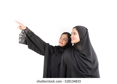 Young Arabic females in traditional dress on white background