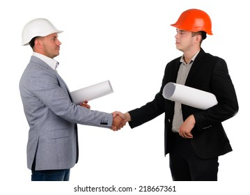 Young architect or engineer wearing a hardhat with a blueprint under his arm shaking hands with a businessman isolated on white