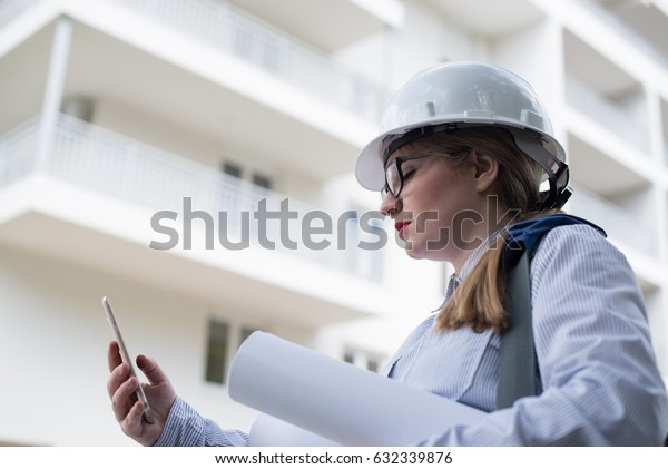 young architect using cell phone