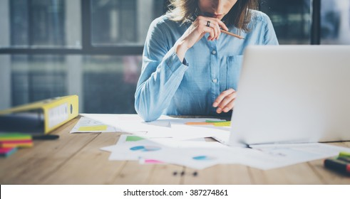 Young architect work project. Photo woman working with new startup project in modern loft. Generic design notebook on wood table. Horizontal, film effect
