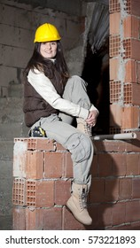 Young architecture woman in a construction