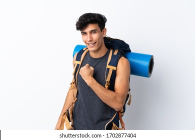 Young Argentinian hiker man over isolated white background celebrating a victory