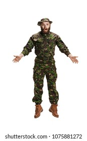 Young army soldier wearing camouflage uniform jumping isolated on white studio background in full-length. Young caucasian model. Military, soldier, army concept. Proffeshional concepts