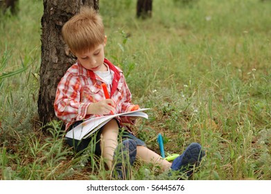young artist drawing outdoor