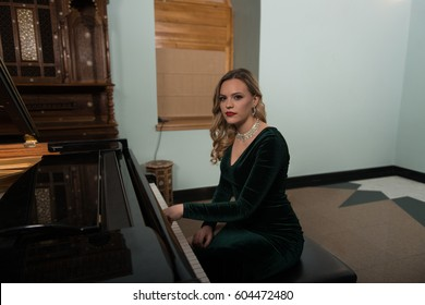Young Artist in Green Velvet Evening Dress Playing at the Old Wooden Piano Classical Sonata by Gentle Candlelight