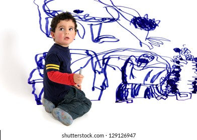 Young artistic boy doing wall painting
