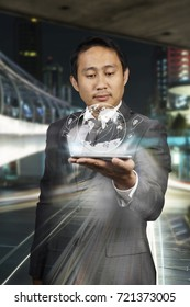 Young asia businessman are showing hologram of links email for commercial connections to around the world and  income by phone.