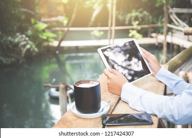 Young asia muslim woman work out office chill on green nature park concept for female entrepreneur job on chic workplace, financial freedom, mature student use internet in university college for meet.