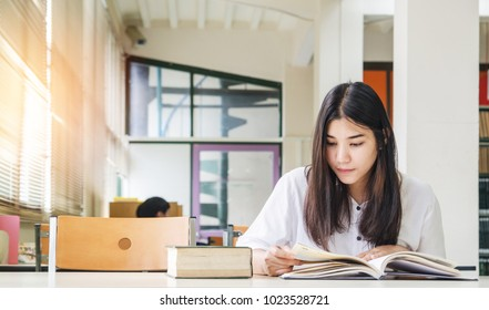 young asia reading book in library , University girl , education concept