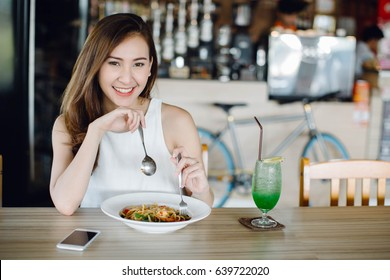 Young Asia woman eating spaghetti at restaurant