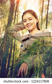 young asia woman smiling happy in the pine forest