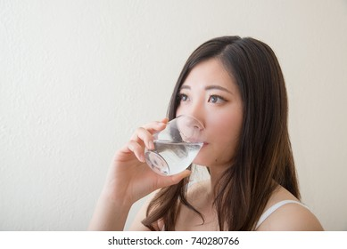 young asia women drinking water