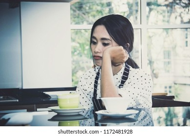 Young asia women worry because of health problems while working in a coffee shop