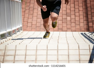 young asian adult male athlete using steps to train speed and strength.