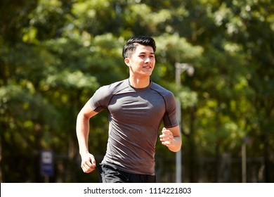 young asian adult man athlete running and training.