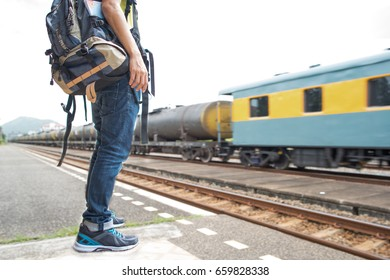 Young asian backpack traveler waiting the train at train station, Solo traveler standing for wait train,